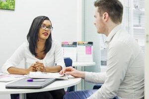 job interview with two people in a white office